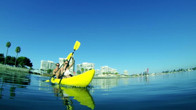 Young Happy Couple Kayaking at Beach Lifestyle video