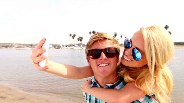 Young Happy Couple Taking Selfie At Beach video