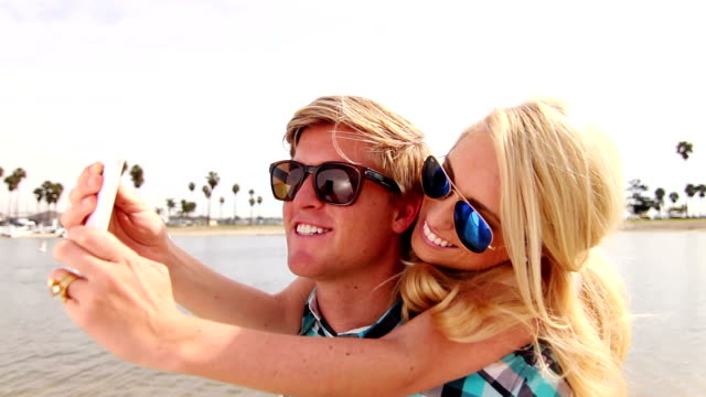 Young Happy Couple Taking Selfie (Self Portrait) At Beach video