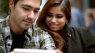 Young happy couple using tablet device video