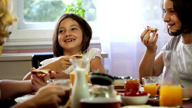 Young Happy Family Having Breakfast video