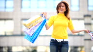 Young happy girl loving shopping. video