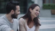 Young Happy Smiling Man and Woman are Communicating Outdoors. Slow Motion Shot. video
