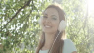 Young happy woman with headphones video