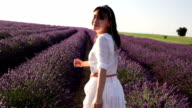 Young health female running in lavender field video