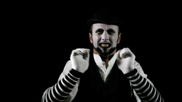 Young hilarious mime shouting using a megaphone video