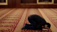 young hippie muslim worship in a mosque video