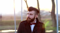 Young hipster relaxes on an iron bridge video