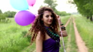 Young hipster woman playing with balloons video
