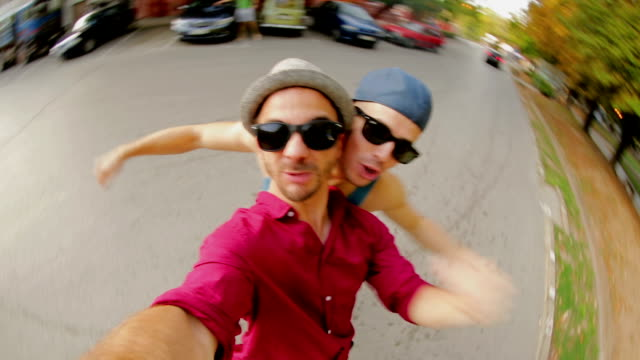 Young hipsters having fun in park video