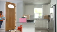 Young Hispanic couple moving in to a new home, slow motion video