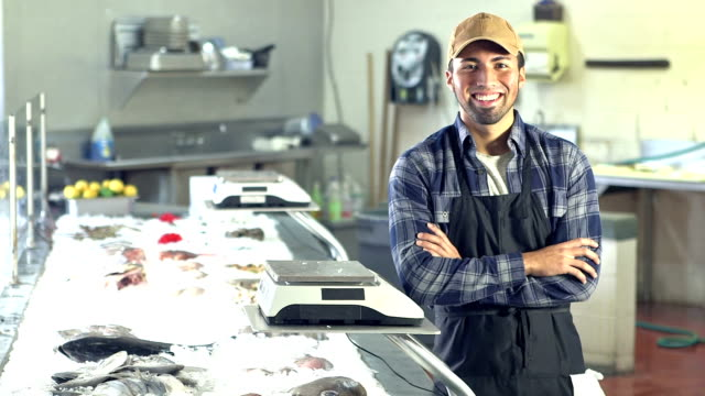 Young Hispanic man working in fish market video
