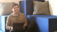Young hispanic man working on tablet in casual coworking space video