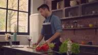 Young husband preparing romantic dinner video