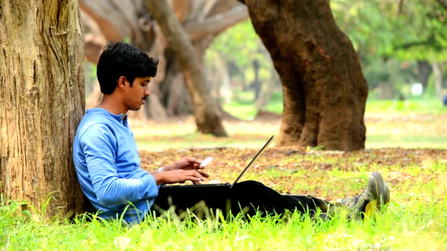 Young Indian Man Purchasing Online Using Credit Card video