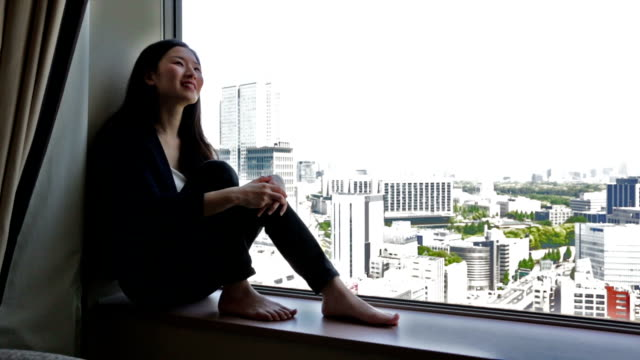 Young Japanese Businesswoman Relaxing With City View video