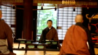 Young Japanese Monks Praying in a Buddhist Temple video