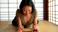 Young Japanese woman using digital tablet video