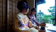 Young Japanese Women Drinking Tea While Wearing Traditional Kimonos video