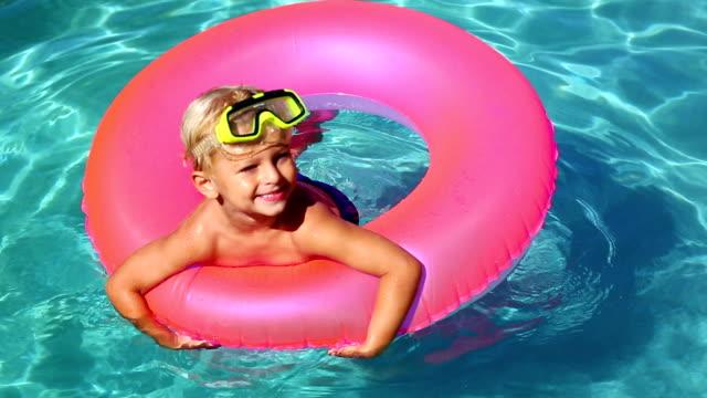Young Kid Having Fun in Swimming Pool video