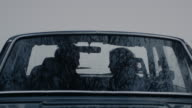 Young loving couple hugging in a car video
