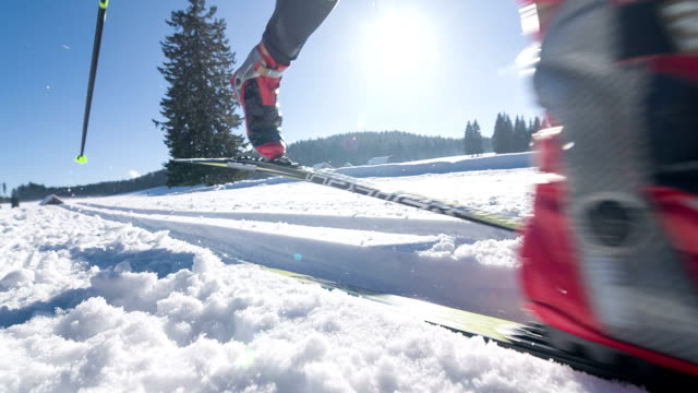 Young male athlete cross country skiing on ski track video