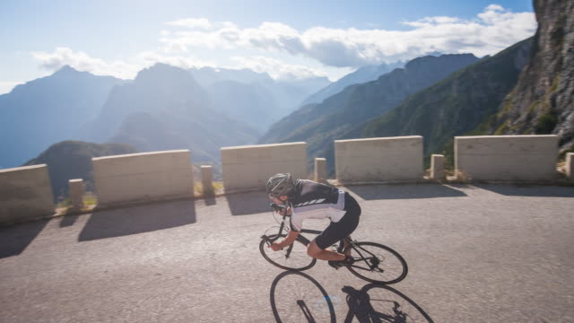 Young male athlete road cycling on a mountain pass video
