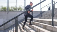 Young male athlete running up the stairs of a stadium video