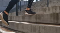 Young male athlete running up the stairs video