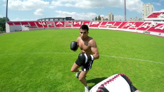 Young male boxer practicing video