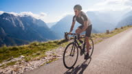 Young male cyclist cycling on a mountain pass video