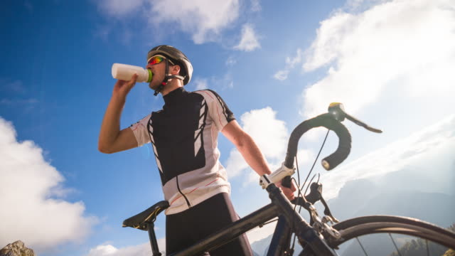 Young male cyclist drinking water video