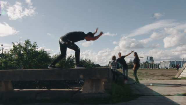 Young Male Freerunner Performing Tricks and Jumps Outdoors in Urban Environment. video