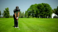Young male playing golf at the golf field video
