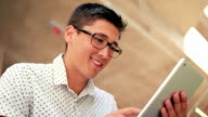 Young Male Student Using Tablet PC At School While Studying video