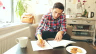Young male studying in coffee shop. video