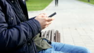 Young male texting on cell phone video