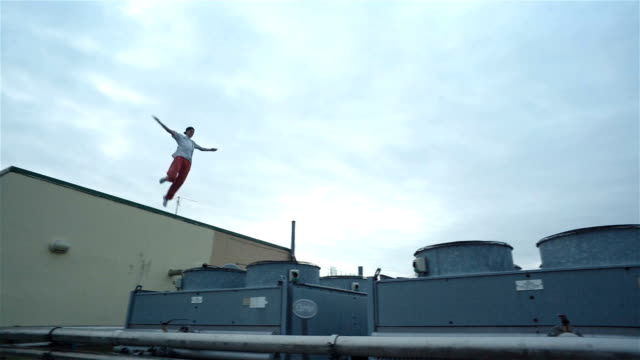 Young Male Tracer On Building Roof video