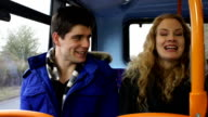 Young man and woman talking on the bus video