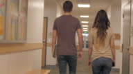 Young Man and Young Woman Walking in Hallway video