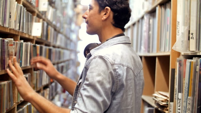 4K: Young man at record store video