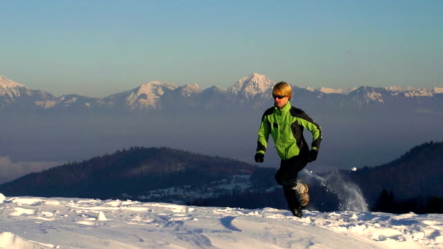 HD: Young man at snow running video