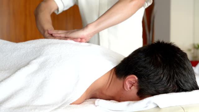Young man at SPA treatment video