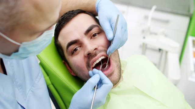 Young Man At The Dentist video