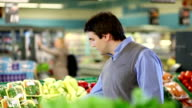 Young man buying vegetable video