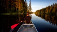Young Man Canoeing in the Wilderness video