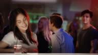 Young man checking out woman at bar video