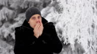Young Man Coughing Winter Outdoors Freezing Hands video