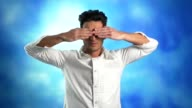Young man covering eyes with his hands video