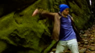 Young man dancing in the canyon video